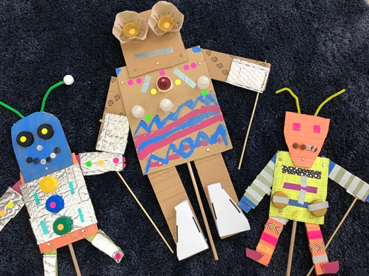 Three-colorful-robot-puppets-made-with-cardboard-and-other-recycled-materials.jpg